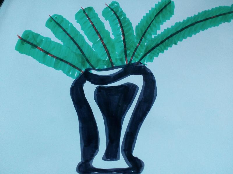 Vase mit Grünzeug.